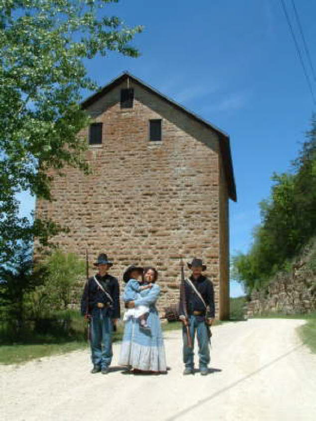 Soliders outside of the mill
